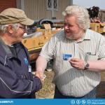 Long time active member Kari Relander (left) receiving his honorary membership status from Club President Juha Lehtonen.