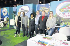 The large, joint Windward Islands stand at the Dutch Holiday Expo (Vakantiebeurs) in Utrecht. From left: Chantal van Heertum of TVC, Charles Lindo and Teena Lopes of St. Eustatius Tourism Development oundation, Bart Kim of TVC, Glenn Holm of Saba Tourist Bureau and Courtney Hassell, an intern at Saba Tourist Bureau.