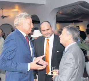 Three Dutch Representatives conversing at Friday's reception at Holland House Beach Hotel, with, from left: Henk Brons, Chris Johnson and Gert Versluis.