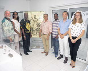 The Emancipation Day recognition at Saba Heritage Center was a first-time event for Saba, with, from left: SABARC President Jay Haviser, Intangible Heritage Committee (IHC) Latoya Charles, Acting Island Governor Franklin Wilson, Island Council Members Carl Buncamper and Vito Charles, SABARC Director Ryan Espersen, and IHC Committee member Stacey Simmons).