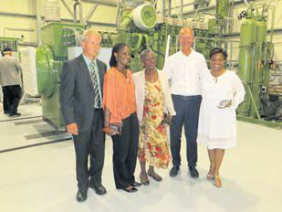 Minister of Economic Affairs Henk Kamp (second right) posing inside Saba Electric Company's new Elmer Linzey power plant with SEC Director Dexter Johnson (left), and Edwina Linzey (centre), widow of SEC founder Elmer Linzey (centre) and their two daughters.