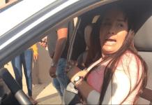 Carolina Abreu Ortega fue esposada dentro de su vehículo en Gurabo Santiago.