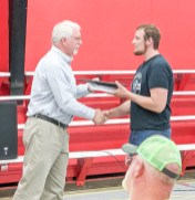 Ross Shumaker receives the Twisters Car Club scholarship from Bart White.