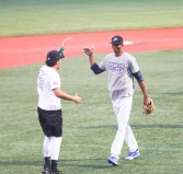 Samuel Mendez shakes hands with a teammate as he walks of the mound on Tuesday, July 13.