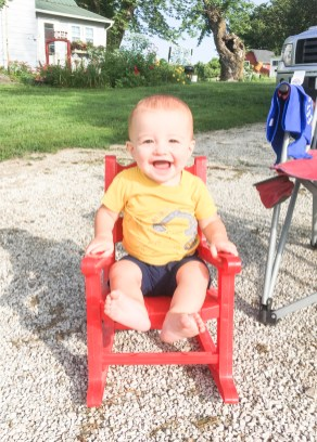 Jackson Manche watches the Tractor Cruise on Saturday, August 14.