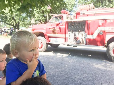 Jordy Johnson watches the parade during Morrill Days on Saturday, August 14.