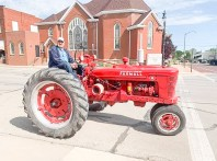 Dale Aue drives a tractor during the Tractor Cruise on Saturday, August 14.