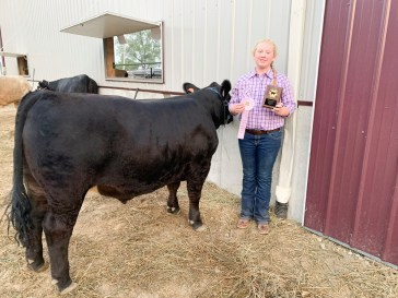 Ava Edelman stands with her Reserve Champion steer at the Nemaha County Fair.