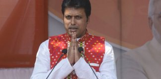 Biplab Deb Touches Manik Sarkar's Feet at Swearing-in