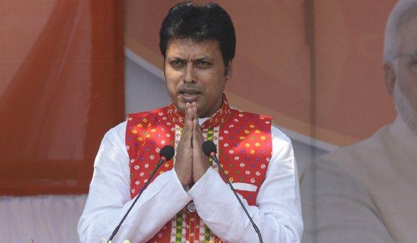 Biplab Deb Touches Manik Sarkar's Feet at Swearing-in