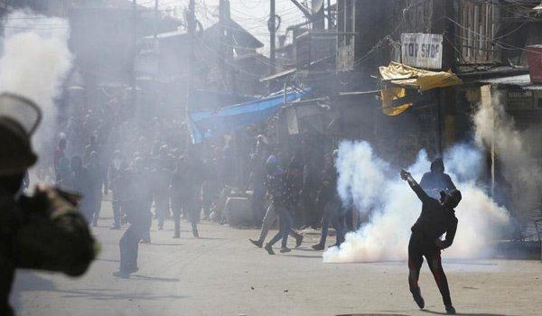 security force burst teargas shells as massive protests erupt in Srinagar