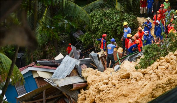 Landslide kills 12 in the Philippines, dozens feared trapped