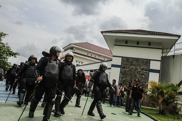 113 prisoners absconding in Indonesia jail, four arrested