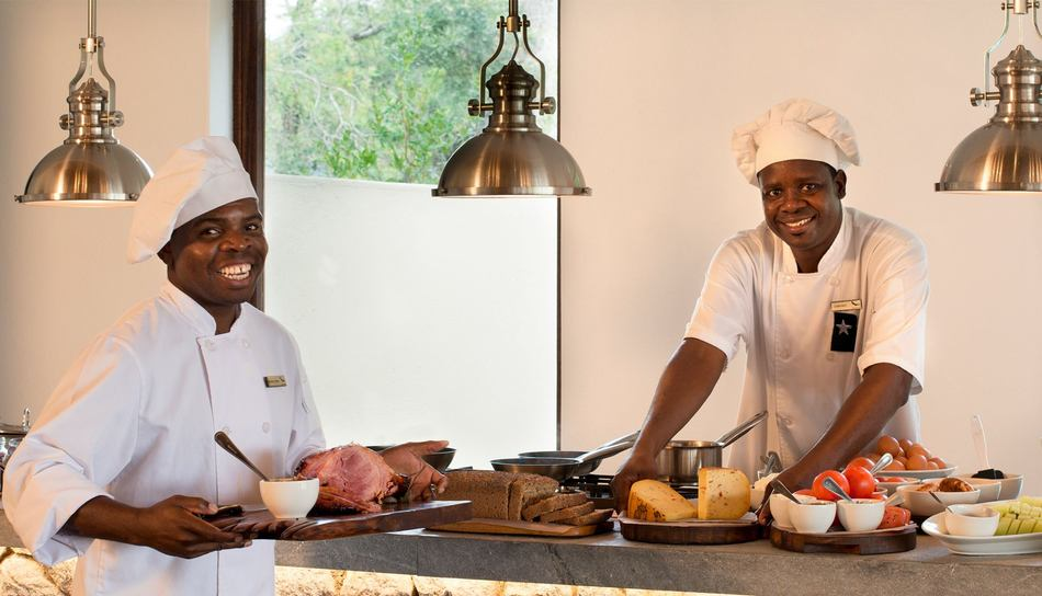 Exeter River Lodge Friendly Staff Members Preparing Food for Guests