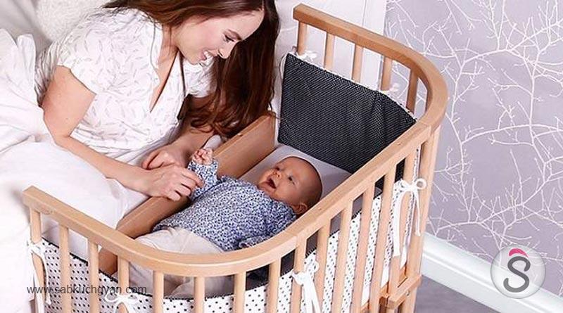 Newborn-baby-boy-sleeping-in-bed 2
