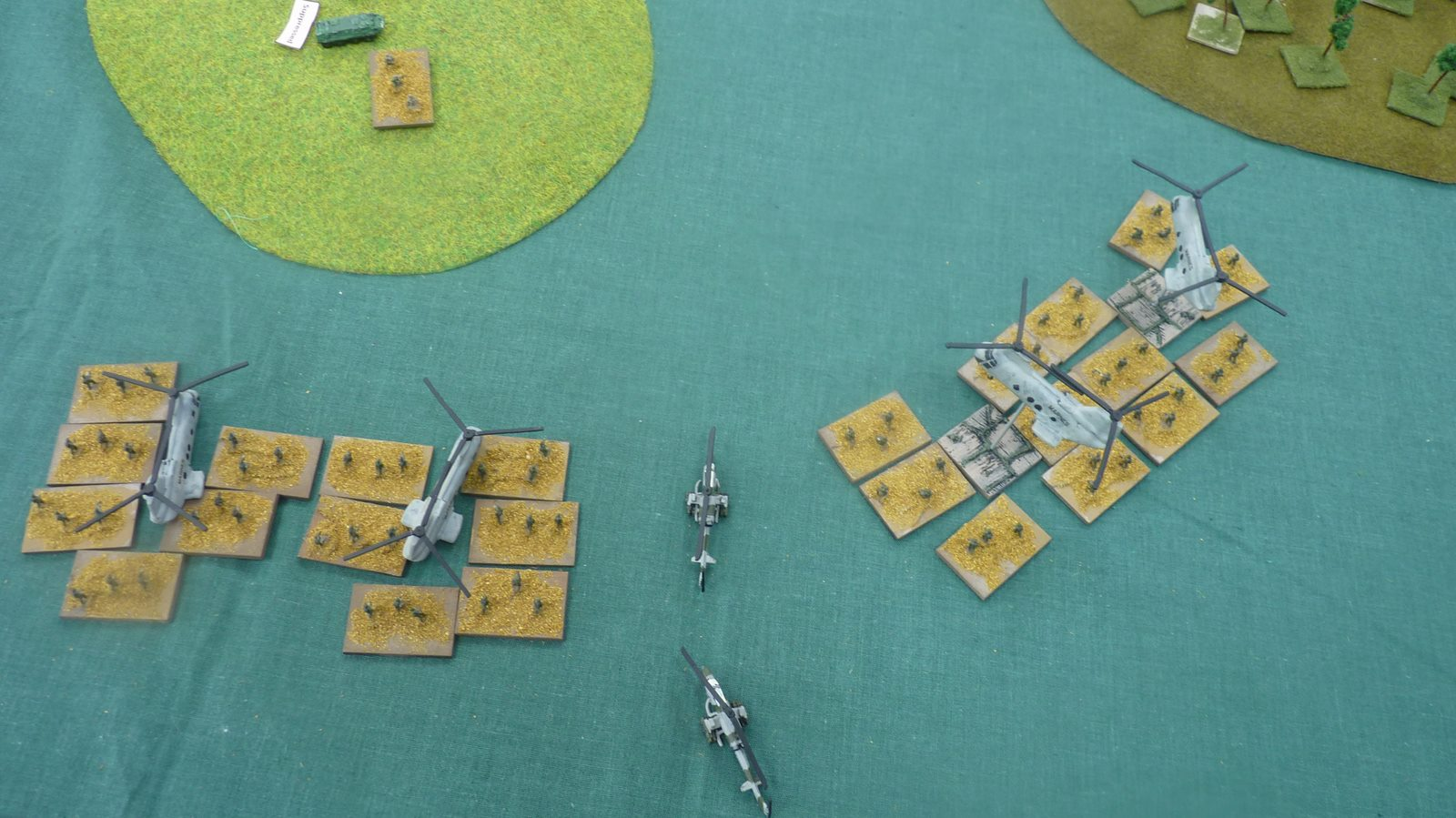 Helicopters land and deposit their infantry