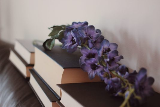 Books and flower.