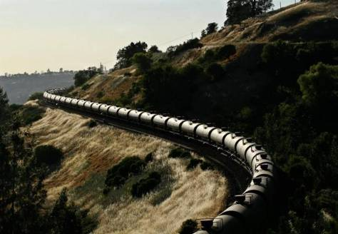 A crude oil train operated by BNSF snakes its way west through James, Ca., just outside of the Feather River Canyon in the foothills into the Sacramento Valley on June 5, 2014.