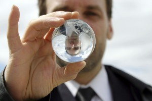 Man holding a crystal ball