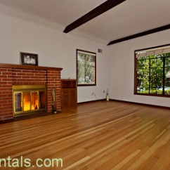 Formal Living Room With Brick Fireplace Coffee Table Set 1570 12th Ave Land Park Sacrentals Com 916 454 6000 Built In Cabinets Garden View Windows Pristine Hardwood Floors Arched Passages Wood Beamed Ceilings