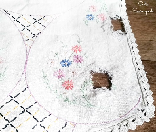 Vintage embroidery with holes and tears for upcycling projects