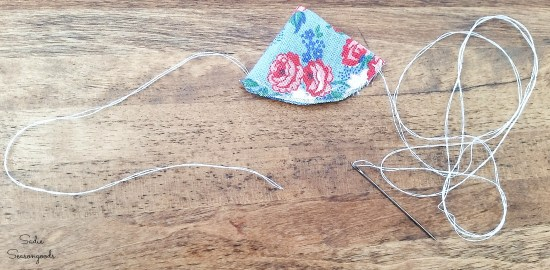 Sewing the petals of cloth flowers from grain sack fabric