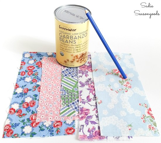 Using a tin can to trace circles on flour sack cloth