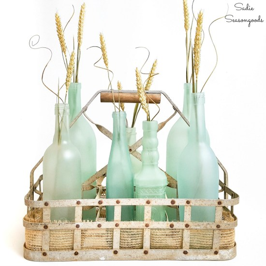 Sea glass bottles as wine bottle crafts for coastal decor