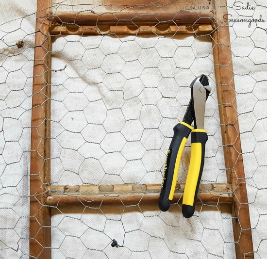 Attaching the chicken wire to an old washboard for primitive farmhouse decor