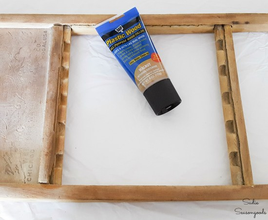Fixing an old washboard with plastic wood to make it more sturdy