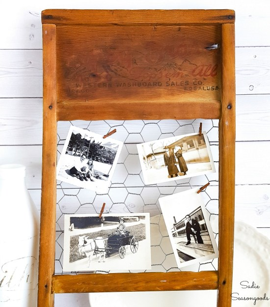 Primitive farmhouse decor with an antique washboard as a chicken wire frame