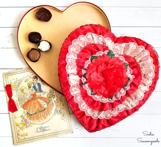 Vintage valentine decorations with a heart shaped candy box