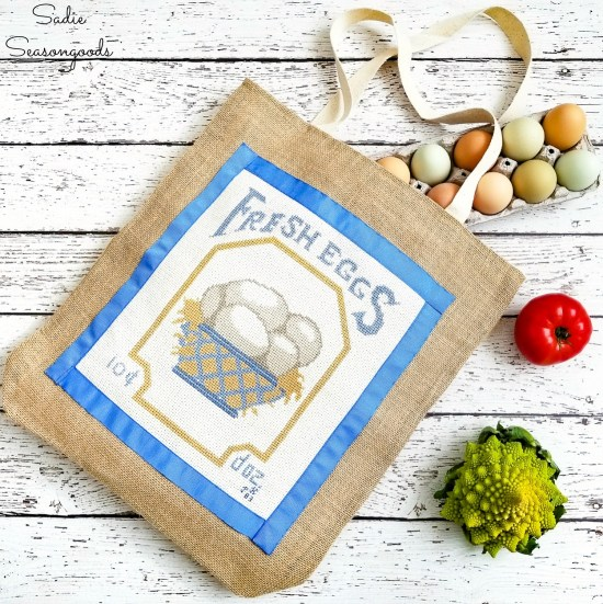 Repurposing a counted cross stitch on a jute tote bag to make a reusable grocery bag