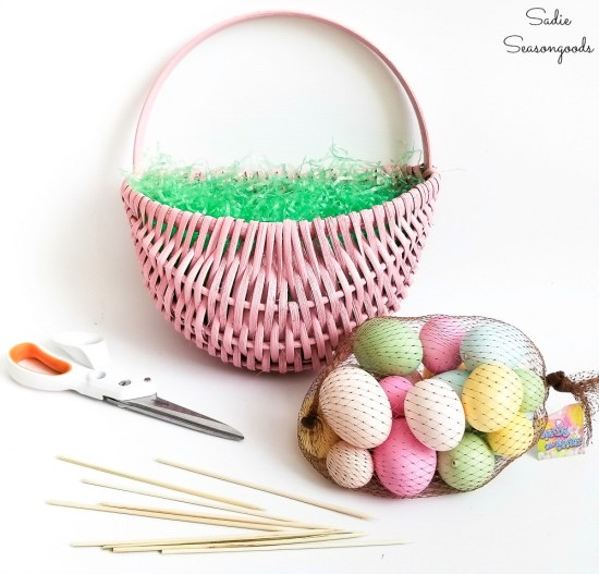 Transforming a hanging door basket into an Easter wreath with eggs and bamboo skewers