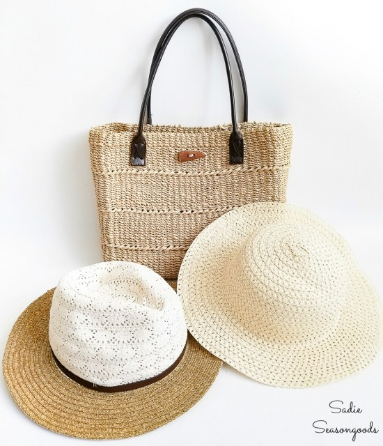Thrift store accessories such as a woven tote bag and straw hats
