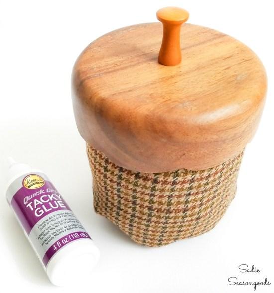 Wooden salad bowl and knob as an acorn cap