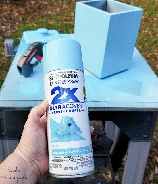 Spray painting the retro canisters to be the aqua kitchen decor