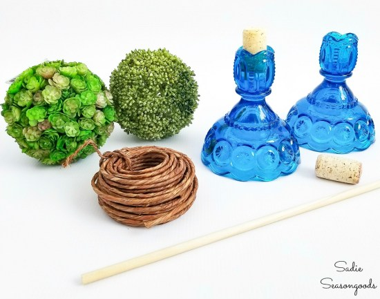 Craft supplies and vintage candlesticks to make the Spring topiaries