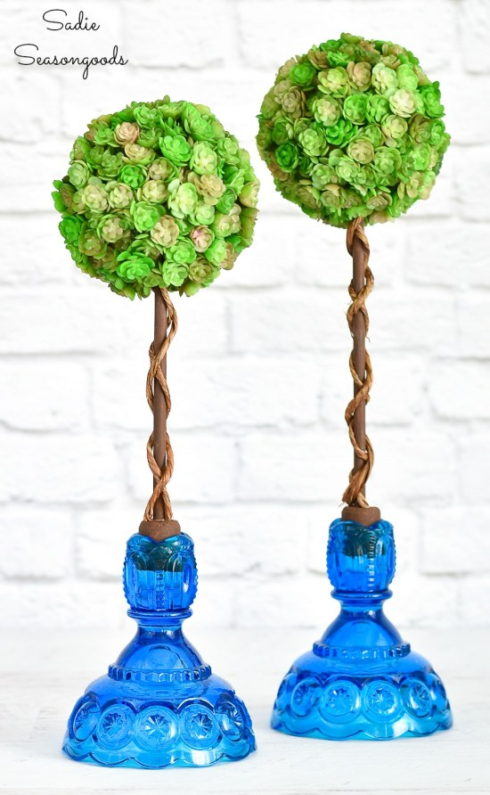 Spring topiaries with vintage candlesticks and wine corks