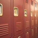 invasive viewing windows in high school locker room