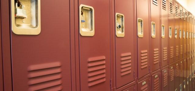invasive viewing windows in high school locker room