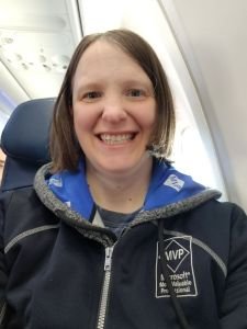 Sadukie wearing her MVP hoodie and MVP jacket on the plane