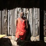Maasai tribe live in enclosures called Enkang which contains ten tow twenty small huts and are protected by fences or bushes with sharp thorns