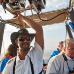 By expertly navigating the vertical landscape the hot-air balloon pilot finds some directional control