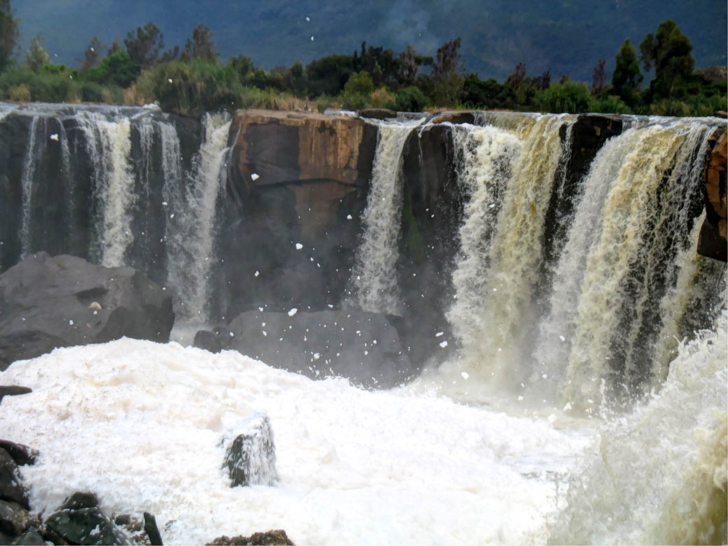 Foam emanating from the Fourteen Falls due to pollution