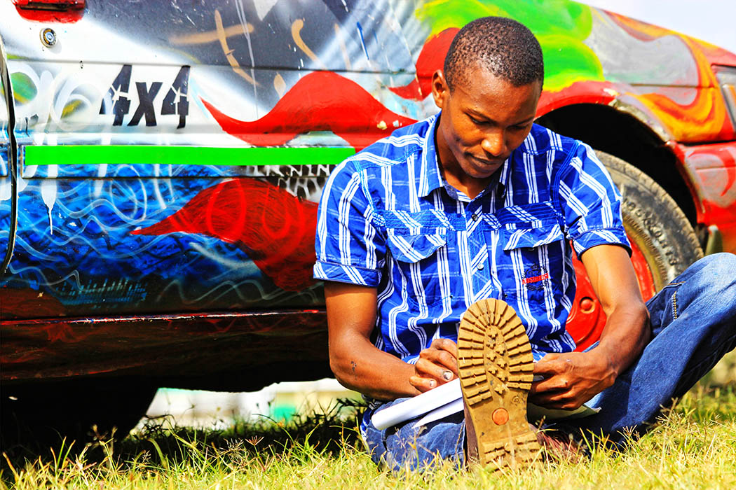 Sights & People from the North Rift_Rich boy sketching
