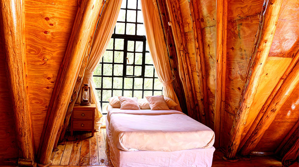 Samawati Conservancy_Deluxe cabin bedroom