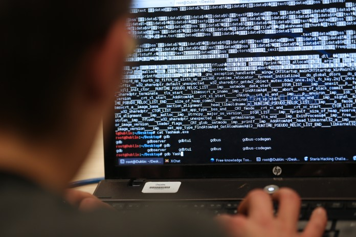 A student from an engineering school attends, on Meudon, west of Paris, overnight on March 16, 2013, the first edition of the Steria Hacking Challenge. AFP PHOTO / THOMAS SAMSON (Photo credit should read THOMAS SAMSON/AFP/Getty Images)