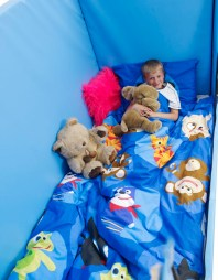 child resting in Hi-lo 2