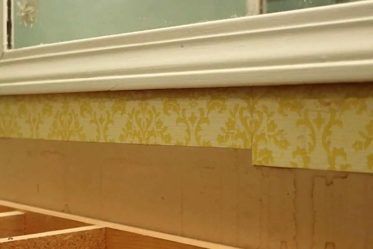 1970's era yellow wall paper in bathroom